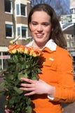 Teenage girl buying roses Stock Photo
