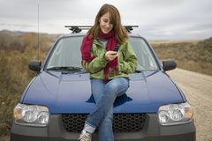 Teenage girl calling on her cell phone Royalty Free Stock Images