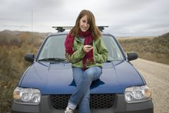 Teenage girl calling on her cell phone Royalty Free Stock Photo