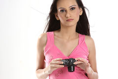Teenage girl with camera Stock Images