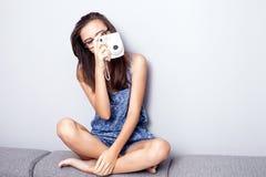 Teenage girl with camera. Stock Image