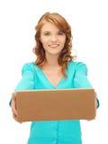 Teenage girl with cardboard box Royalty Free Stock Photos