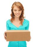 Teenage girl with cardboard box Stock Photography