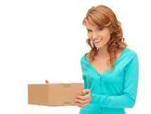 Teenage girl with cardboard box Stock Images
