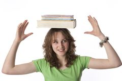 Teenage Girl Is Carrying Books On Her Head Stock Photos