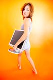 Teenage Girl Carrying Monitor - 2 Royalty Free Stock Photo