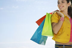 Teenage Girl Carrying Shopping Bags Outdoors Royalty Free Stock Images