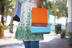 Teenage Girl Carrying Shopping Bags On Street Stock Photos