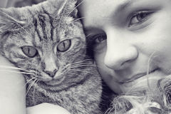 Teenage girl and cat Stock Images