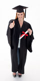 Teenage Girl Celebrating Graduation with thumbs up Royalty Free Stock Photo