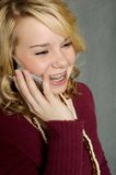 Teenage Girl on Cell Phone. Teenage Girl smiling while talking on a cell phone stock photos