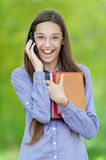 Teenage girl on cell phone says Royalty Free Stock Image