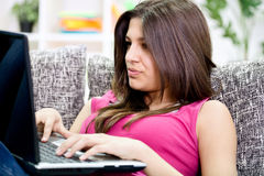 Teenage girl chatting on internet Royalty Free Stock Images