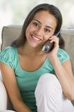 Teenage Girl Chatting On Telephone. Smiling stock images
