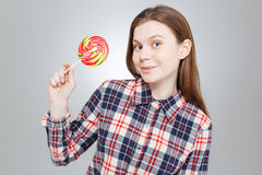 teenage girl in checkered shirt holding lollipop Royalty Free Stock Photos