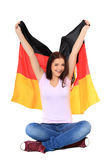 Teenage girl cheers with german flag Stock Photo