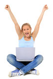 Teenage girl cheers while using laptop Royalty Free Stock Photos