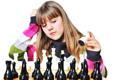 Teenage girl and chess royalty free stock photography