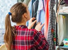Teenage Girl Choosing Clothes. From Wardrobe stock photo