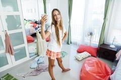 Teenage girl choosing clothing in closet royalty free stock photos