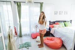Teenage girl choosing clothing in closet Stock Photos