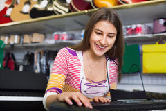 Teenage girl choosing synthesizer Stock Image