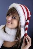 Teenage girl with christmas hat Stock Images
