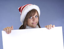 Teenage girl with christmas hat Royalty Free Stock Photo