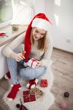 Teenage girl with Christmas presents. In her room Stock Photography