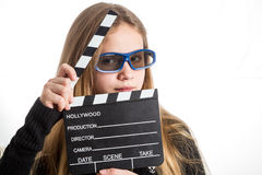 Teenage girl with clapperboard Royalty Free Stock Photos