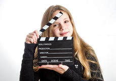 Teenage girl with clapperboard stock photography