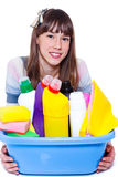 Teenage girl with cleaning agents Stock Photo
