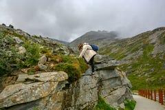 Teenage girl climbs the rocks royalty free stock photos