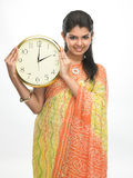 Teenage girl with clock Royalty Free Stock Photo
