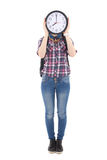 Teenage girl with clock covering face isolated on white Royalty Free Stock Photography