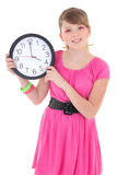 Teenage girl with clock isolated over white Royalty Free Stock Photography