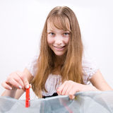 Teenage girl with clothes-peg Stock Photography