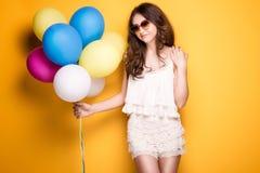 Teenage girl with colorful balloons, studio shot. Royalty Free Stock Photos