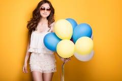 Teenage girl with colorful balloons, studio shot. Stock Photo