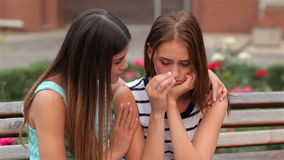 Teenage girl consoling her sad upset friend stock video footage