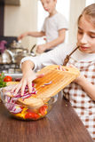 Teenage girl cooking together with her family royalty free stock images