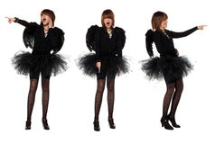Teenage girl in costume of black angel. Teenage girl is wearing costume of black angel during masquerade party, isolated on white background. She points her Stock Photos