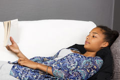 Teenage girl in couch stock photography