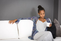 Teenage girl in couch Royalty Free Stock Photography