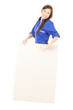 Teenage girl in coveralls with empty board Royalty Free Stock Image