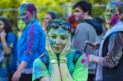 Teenage girl covered in green powder. Cute teenage girl holding her face covered with green colored powder at the Color Run event on April 26 in Bucharest Royalty Free Stock Images