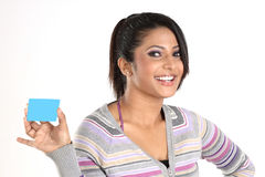 Teenage girl  with credit card. Smiling girl with blue credit card Stock Photo