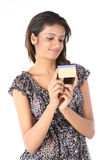 Teenage  girl with  credit card. Teenage Girl with gold color credit card over white background Royalty Free Stock Photography