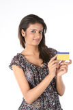 Teenage  girl with  credit card. Teenage Girl with gold color credit card over white background Stock Images