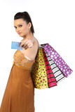 Teenage girl with  credit card and bags. Teenage girl standing with credit card and shopping bags Royalty Free Stock Images